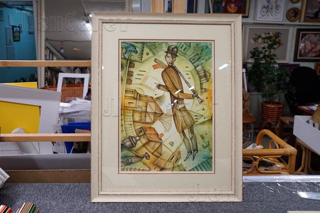 """Рисунок """"Дудочник"""" в кремовой багетной рамке с двойным паспарту"""